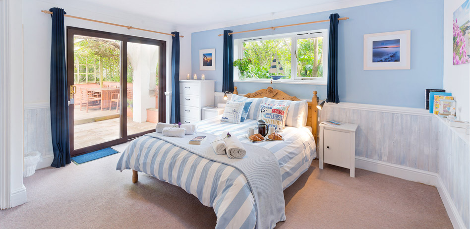The spacious master bedroom with with king-size bed and en-suite at The Beach Haven holiday accommodation in Cornwall
