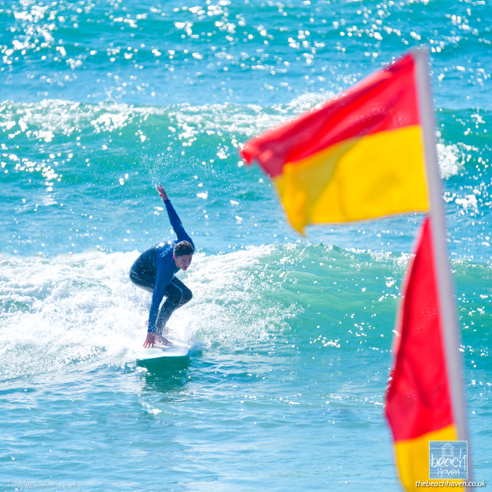 Surfer and flags