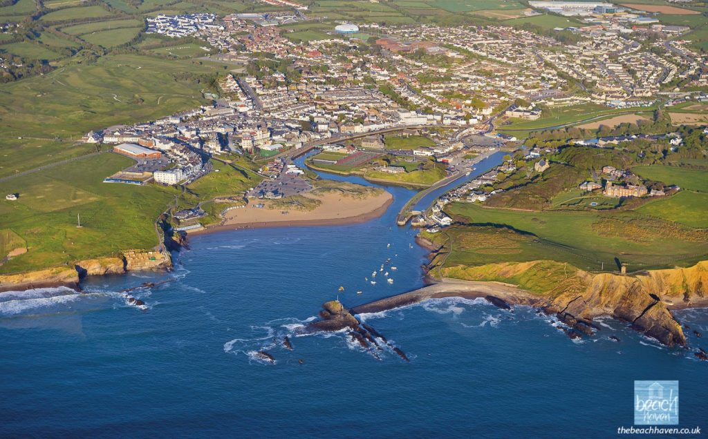 Bude town nestles behind the breakwater and Summerleaze beach
