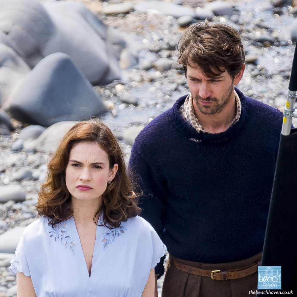 Lily James and Michiel Huisman on set at Sandymouth during filming Guernsey Literary and Potato Peel Pie Society in May 2017
