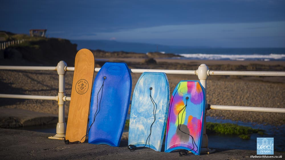 The selection of unbreakable bodyboards and a traditional wooden bellyboard all provided at The Beach Haven