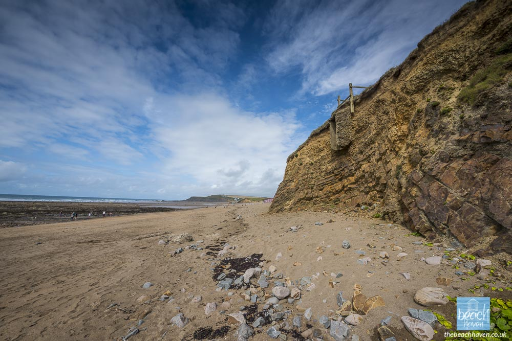 All that remains of the second Widemouth pillbox is the entrance, which now protrudes from the cliff. There are some concrete chunks of the remains in the sand underneath.