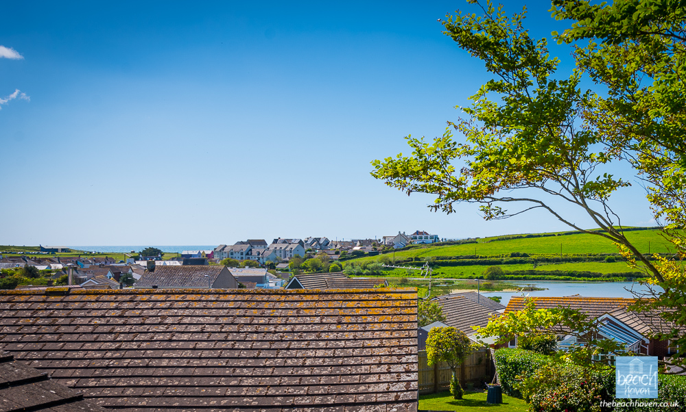 Views to Maer Lake, the clifftops and the sea from the roof terrace at Beach Haven dog-friendly holiday cottage at Bude in Cornwall