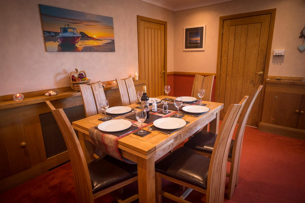 The dining area of the Beach Haven dog-friendly holiday cottage at Bude in Cornwall