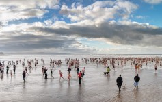 Christmas Day swim at Crooklets beach, Bude, Cornwall