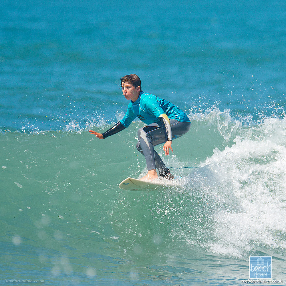 Boy surfing at Bude