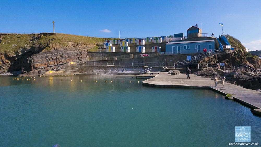 The wonderful sea pool looking serene and showing off the new 'Hub' changing rooms and information centre.