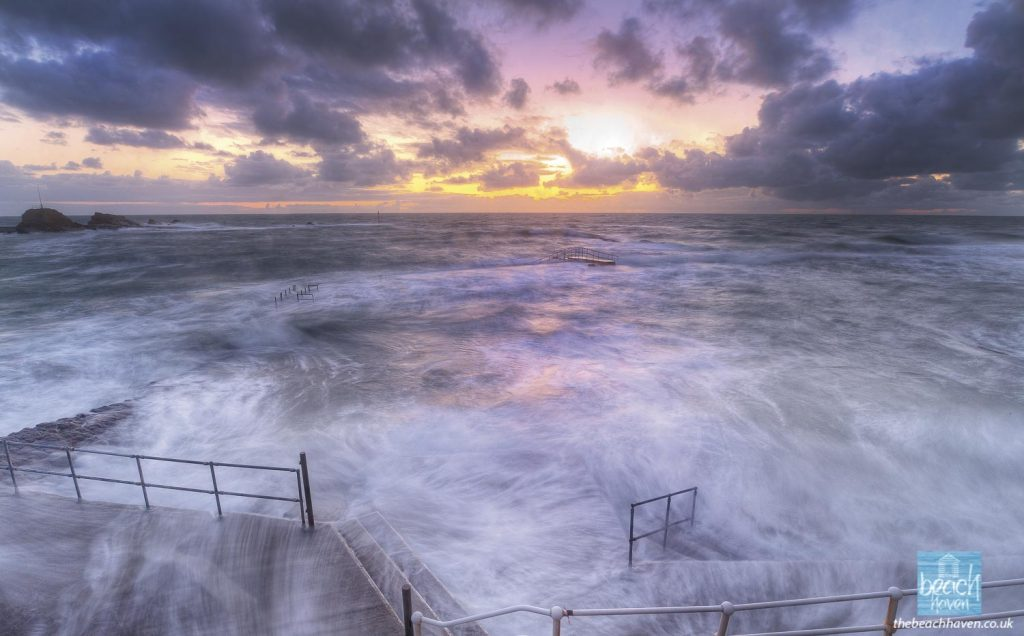 A stormy evening at Bude Sea Pool at high tide
