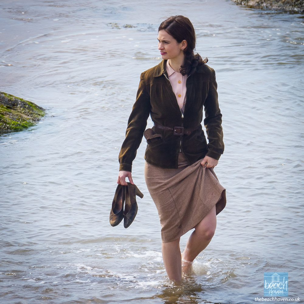 Lily James filming Sandymouth beach during filming the Guernsey Literary Potato Peel Society at Sandymouth near Bude