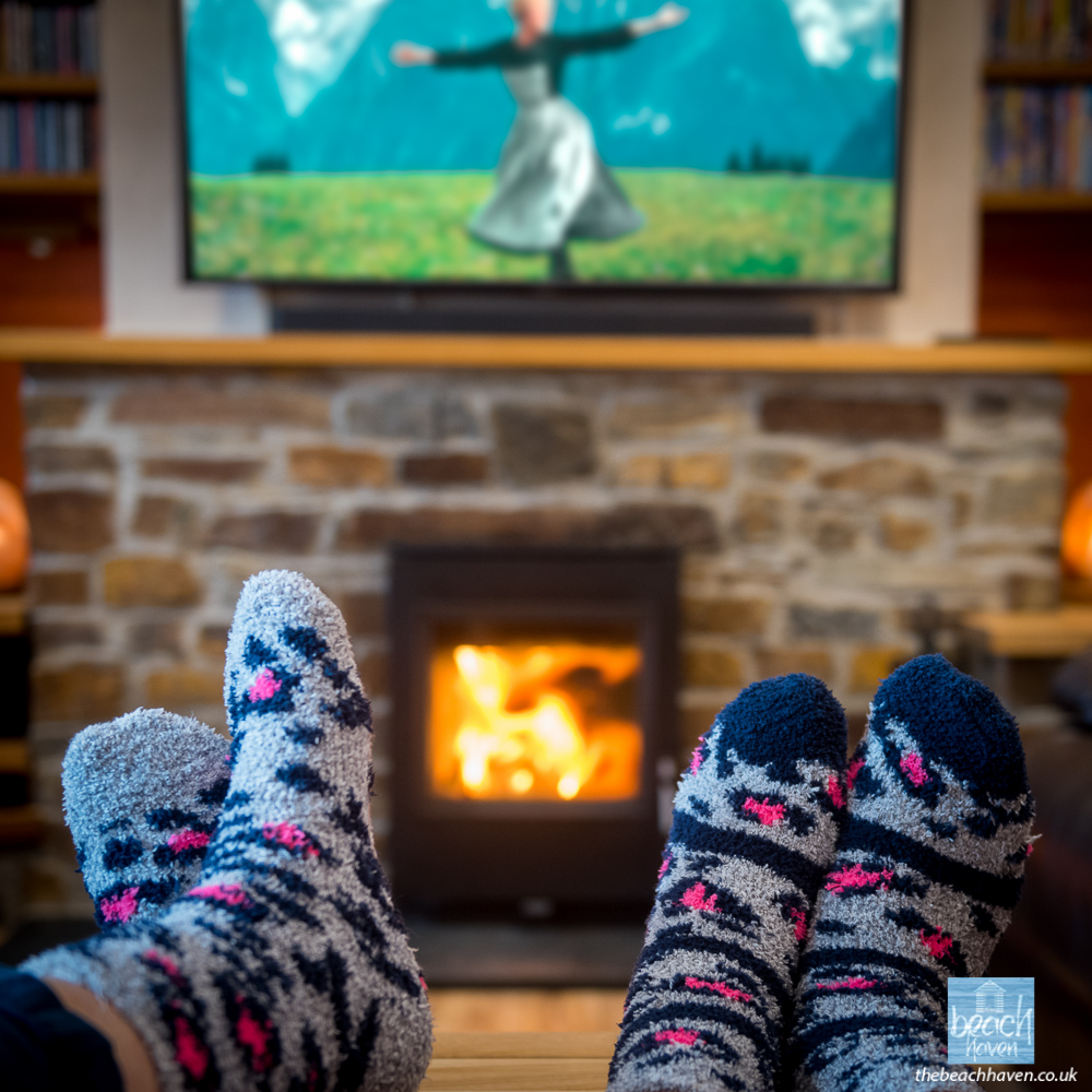 "Cosy woodburner and 55"" smart TV & Dolby Atmos soundbar and subwoofer."